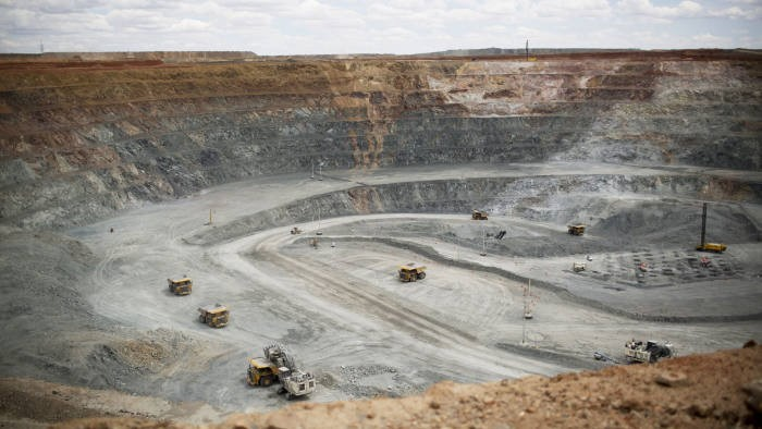 Inside Mongolia's Oyu Tolgoi Copper-Gold Mine...Bloomberg Photo Service 'Best of the Week': Heavy machinery operate inside an open pit at the Oyu Tolgoi copper-gold mine, jointly owned by Rio Tinto Group's Turquoise Hill Resources Ltd. unit and state-owned Erdenes Oyu Tolgoi LLC, in Khanbogd, the South Gobi desert, Mongolia, on Tuesday, June 17, 2014. Mongolia's Vice Minister for Mining Erdenebulgan Oyun said mining law amendments would increase MongoliaÕs area available to mining and exploration to 20 percent from around 8 percent, by lifting a 2010 ban on new licenses. The period of exploration would also increase from nine years to 12 years. Photographer: Brent Lewin/Bloomberg